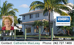Huge price reduction on large canal front town home in gated community on Grand Bahama