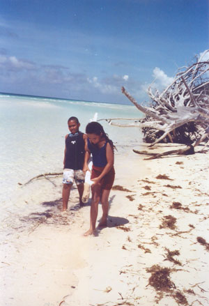Casuarina-cleaning-at-Lucayan-National-Park.jpeg.jpg