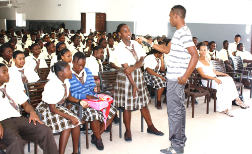 Kazz_Forbes_of_Saint_George_Fashion_House_getting_questions_whilst_delivering_his_speech_at_Clement_Howell_High_School.JPG