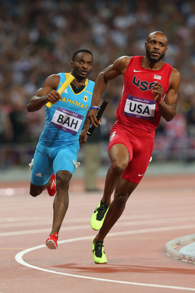 Ramon_Miller__L__of_the_Bahamas_and_Angelo_Taylor_of_the_United_States_compete_during_the_Men_s_4_x_400m_Relay_Final_on_Day_14_of_the_London_2012_Olympic_Games_at_Olympic_Stadium_on_August_10__2012.jpg