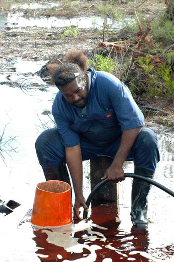 Emergency-worker-vaccuming-diesel-fuel-in-Eleuthera.jpg