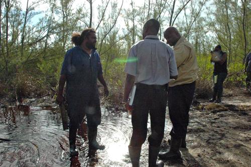 Environment_Minister_Dorsett_speaks_to_DEHS_Inspector_and_Emergency_Worker.jpg