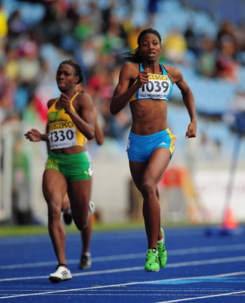 Gold-medal-winner-Shaunae-Miller-of-the-Bahamas-_r_-in-action-on-her-way-to-winning-the-Girls-400-metres-race-during-day-three-.jpg