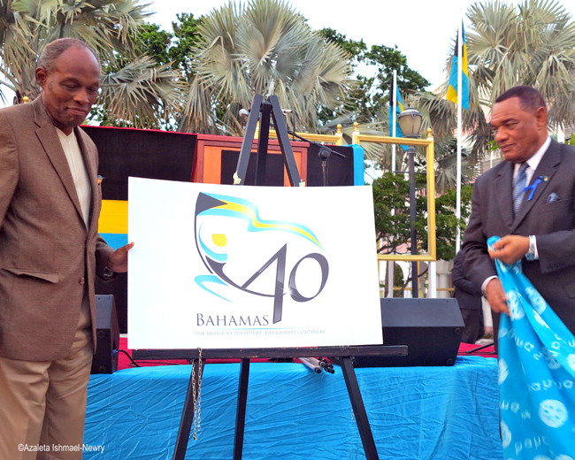PM-Christie-and-Charles-Carter-unveil-40th-celebrations-logo.jpg