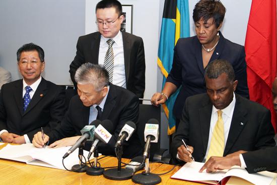 Mitchell_Chinese-Signing-Visa-Exemption-Agreement-Dec-19_-2013---77343.jpg