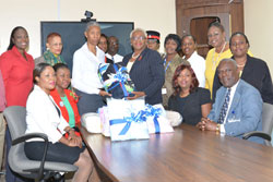 sm-Kay-Smith_-Director-of-Human-Resources-and-Community-Relations-Presenting-the-Rand-Memorial-Hospital-With-Donated-Blankets.jpg
