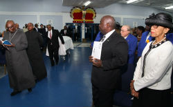 Deputy_Prime_Minister_and_Attorney_General_Pay_Their_Respects_to_the_Late_Count_Bernadino_sm.jpg