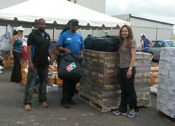 Pic_3-Domino_s_Donates_to_Hurricane_Volunteers_at_Odyssey_Aviation.jpg