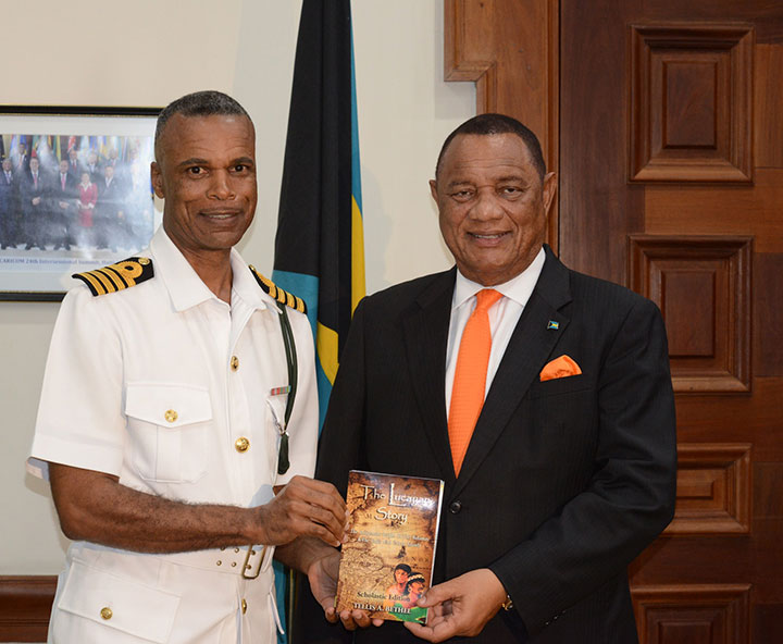 Captain-Tellis-Bethel-Presents-Book-to-the-Prime-Minister.jpg