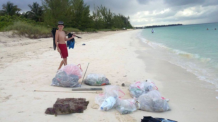Justin-Snisky-II-surveys-the-marine-debris-collected-by----the-EARTHCARE-volunteers.jpg