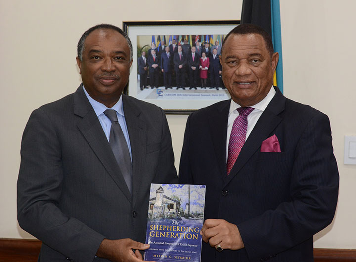 PS-Melvin-Seymour---Presents-Book-to-PM.jpg
