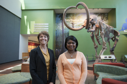 Photo_1_AMMC_Miller_with_Darcie_Macmahon__Director_of_Exhibits___Public_Programs_and_I_in_front_of__the_Columbian_Mammoth_in_the_Main_Gallery_of_the_Florida_Museum_of_Natural_History.-1-small.jpg