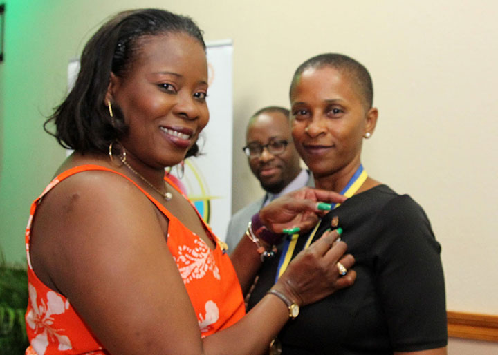 President-Lillian-receives-her-President_s-pin-from-IPP-Bridgette-RCSEN-2016.jpg