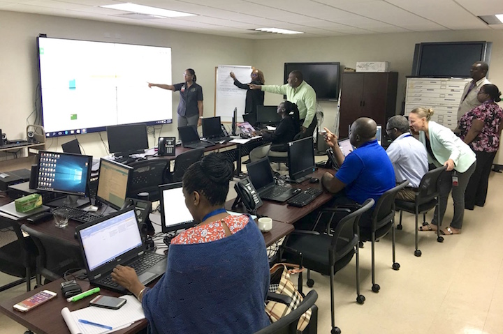 Representatives_from_the_4_Regional_Agencies_discussing_events_being_logged_into_the_Virtual_Crisis_Room_at_CDEMA_s_Regional_Coordination_Centre_.jpeg