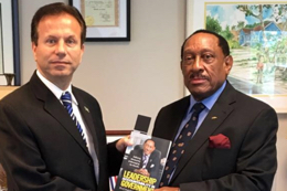Richard_Demeriette_presents_new_book_to_Ambassador_Joudi-small.jpg