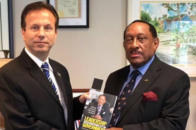 Richard_Demeriette_presents_new_book_to_Ambassador_Joudi.jpg