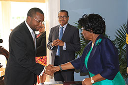 SM-Attorney-General-shakes-hands-with-Dame-Pearlette-Louisy-as-Cabinet-Secretary-Philip-Dalsou-looks-on_.jpg
