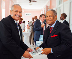 Sir-Orville-presents-a-signed-copy-of-his-book-to-Dr.-Rodney-Smith_-president-of-the-University-of-The-Bahamas.-rz.jpeg