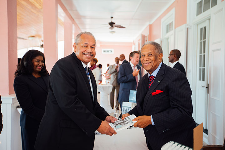 Sir-Orville-presents-a-signed-copy-of-his-book-to-Dr.-Rodney-Smith_-president-of-the-University-of-The-Bahamas.-rz.jpg
