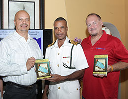 sm-Book-Presentation-to-Tommy-Thompson-at-Marina-Operators-Meeting-August-2016-edited.jpg