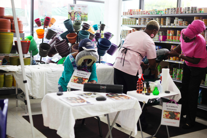 2_Customers_receive_free__relaxing_back_massages_at_Solomon_s_Anniversary_Event_and_Health_Fair.jpg
