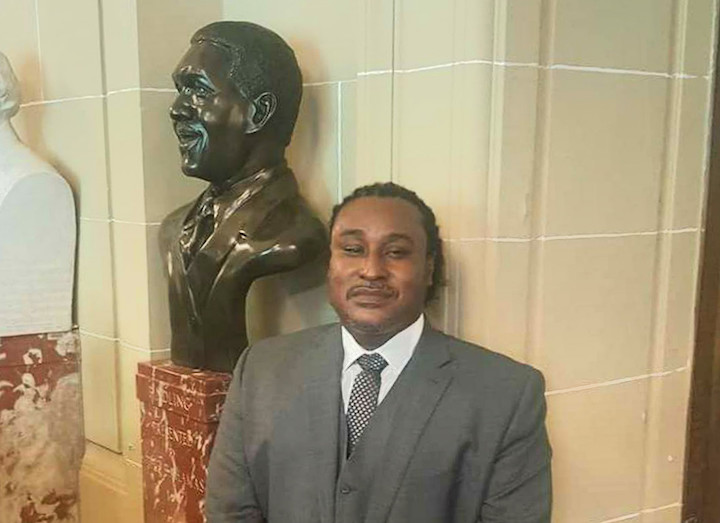"Bahamian artist Andret John is pictured with the bust of the late Sir Lynden Pindling, the first Prime Minister of The Bahamas, after it was unveiled in the Hall of Heroes of the Organization of American States (OAS) on Thursday, April 20, 2017. John, who was born in Eleuthera in 1973, the year that The Bahamas attained independence from Great Britain under the leadership of Sir Lynden, said he was ""beyond excited when I got the news of being commissioned to sculpt the bust of Sir Lynden."" ANDRET_JOHN_AND_BUST.jpg"