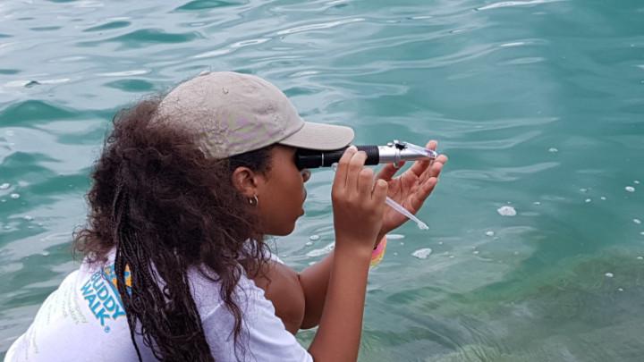 Female_camper_studying_water_sample_1_.jpg