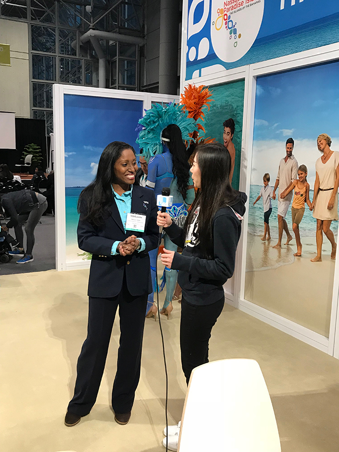Mikala_Moss_Area_Mngr_NY_being_interviewed_at_NY_Times_Travel_Show.jpg