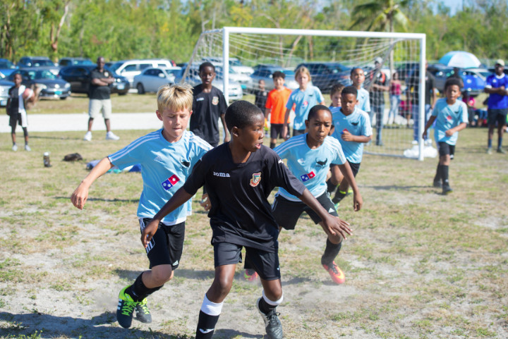 Photo_1-_Players_go_hard_at_Domino_s_Manta_Rays_Inaugural_soccer_tournament_.jpg