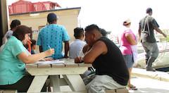 S_Claudia_interviewing_at_Northern_Fishermen_s_Co-op_Belize.jpg
