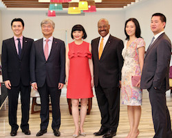 Sm-_Chui_family_welcome_guests_at_Warwick_PI_Bahamas_opening_photo_Azaleta_IMG_4351.jpg
