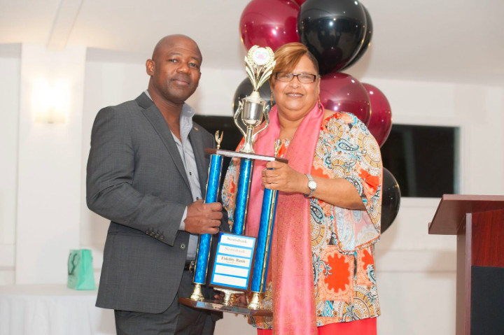 kim_bodie_bifs_executive_director_awards_crestwell_gardiner_vice_president_fidelity_bank_bahamas_limited_with_floating_trophy.jpg