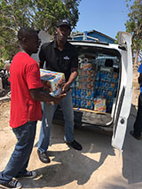 sm-Aliv-offloads-goods-to-be-given-to-residents-of-Haitian-Shanty-Town-.jpg