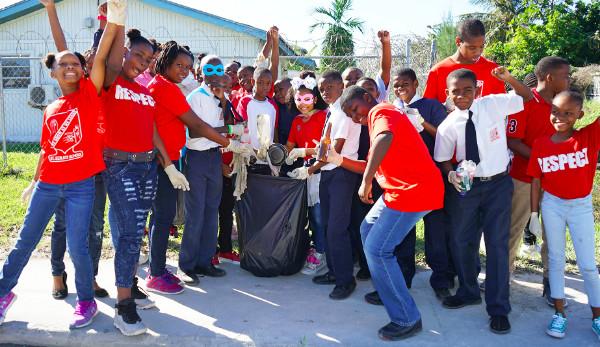 01312019_StCecilia_sBeAHero15_-_group_of_students_with_trash_bag.jpg