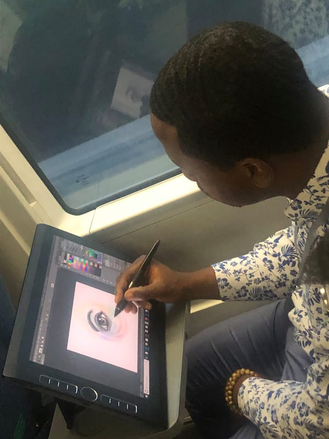 3_Jamaal_drawing_eye_for_A_Vision_United_on_the_train.jpeg