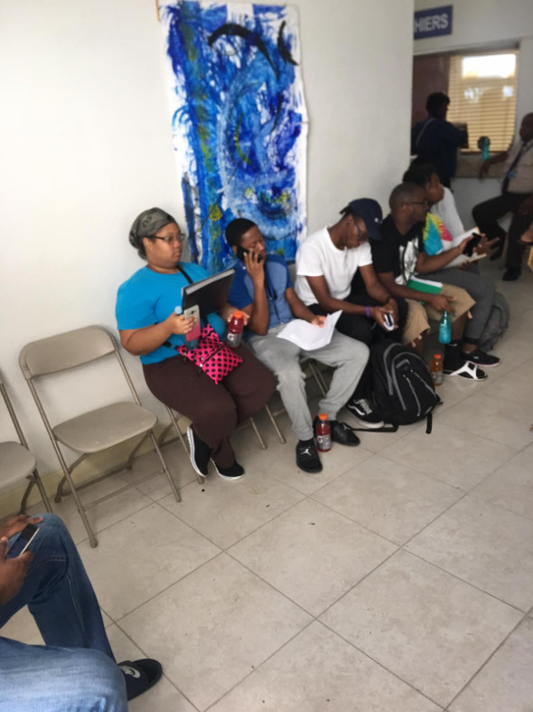 A_few_students_waiting_to_make_payments_at_the_Business_Office__Accounts_Receivable.jpg