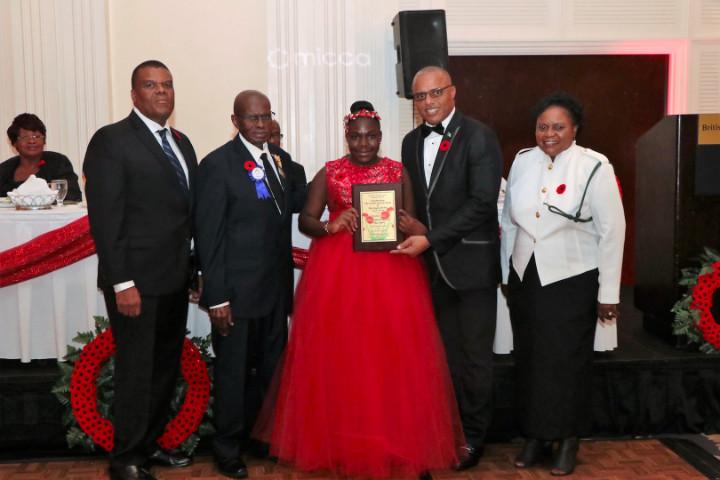 Centennial_Miliary_Ball_-_Clintaysia_Ferguson_with_Award_from_Minister_Dames_1_.jpg