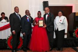 Centennial_Miliary_Ball_-_Clintaysia_Ferguson_with_Award_from_Minister_Dames_1__1_.jpg
