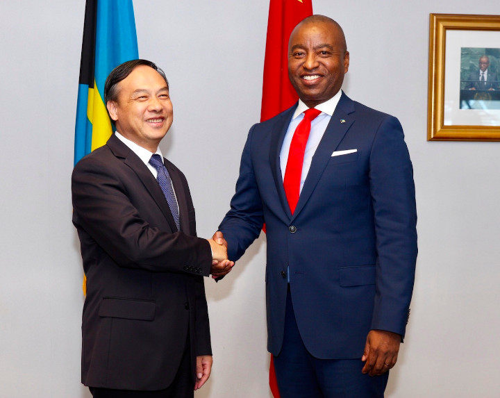 Chinese_Ambassador_and_Minister_of_Foreign_Affairs_in_Handshake_at_Signing_Ceremony.jpg