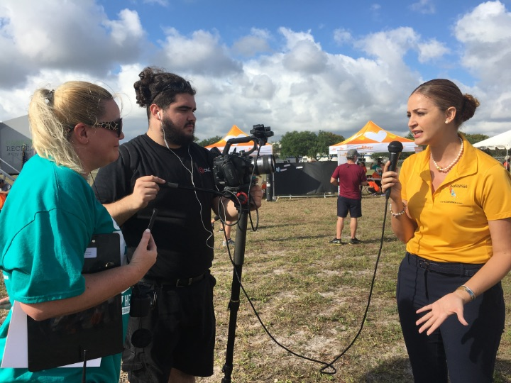 District_Manager__Bahamas_Tourist_Office__Florida__being_interviewed_at_5K_On_The_Runway_Race.jpg