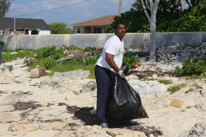 George_Williams__EARTHCARE___________Volunteer_and_Resident_of_Williams_Town_working_at_the_EARTHCARE_____World_______Oceans_Day_2019_Beach_Cleanup.jpg