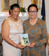 Her_Excellency_was_presented_a_book_from_Mrs._Emily_Osadebay_June_4__2018____235599_1__1_.jpg