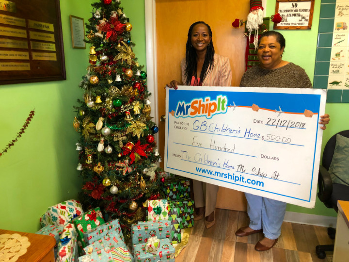 Mr_Ship_It_Freeport__Manager_presenting_gifts_and__500_Donation_to_the_Grand_Bahama_Children_s_home.jpg