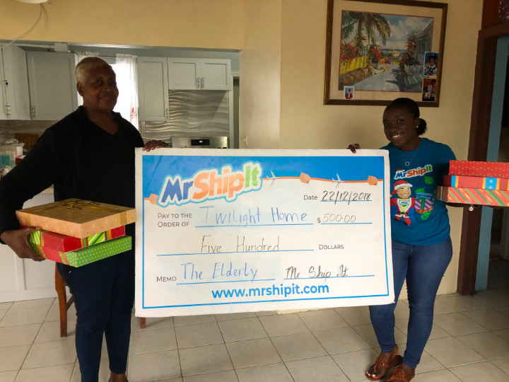 Mr_Ship_It_presenting_Gifts_and_cheque_donation_to__to_.jpg