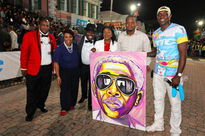 New_Year_s_Day_Junkanoo_-_Minister_Lanisha_Rolle__artist_Jamaal_Rolle__with_Ronnie_Butler_Portrait_1_.jpg