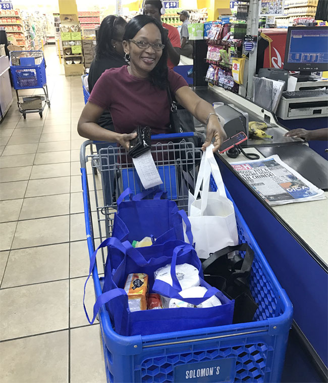 Photo_Caption_1-Shopper_using_recycled_bags_at_BYOB_initiative_on_Grand_Bahama.jpg