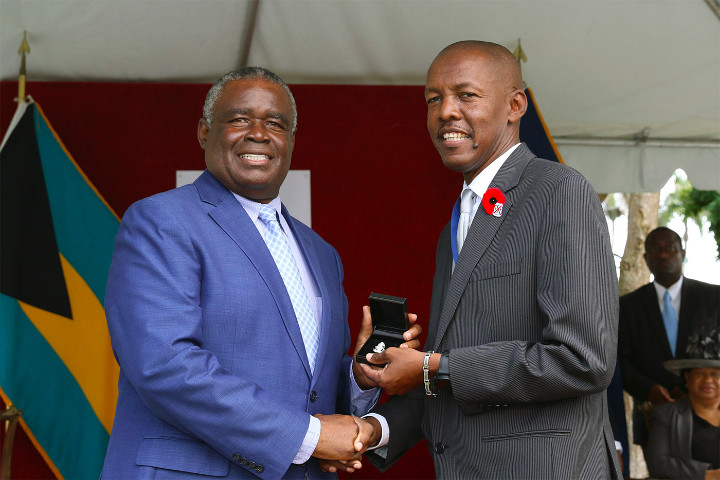 Ralph_McKinney_with_Minister_Rolle.jpg