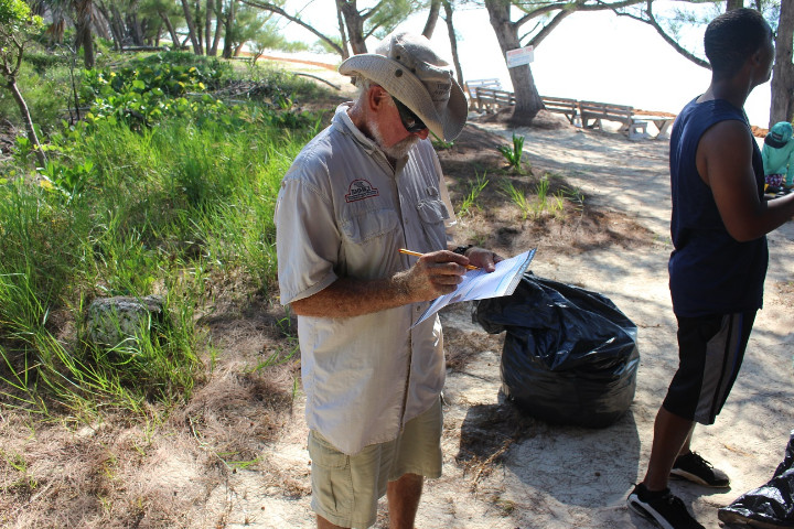 Renowned_Underwater_Naturalist_Ben_____Rose_fills_out_his_data_card_on_International_Coastal_Cleanup_Day.jpg