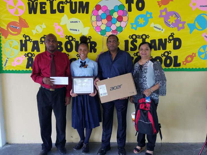 Scholarship_Recepient_with__Principal_and_Romalia_s_Townhouse_Team_1.jpg