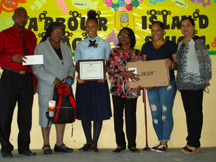 Scholarship_Recepient_with_her_mom___Principal_and_Romalia_s_Townhouse_Team.jpg